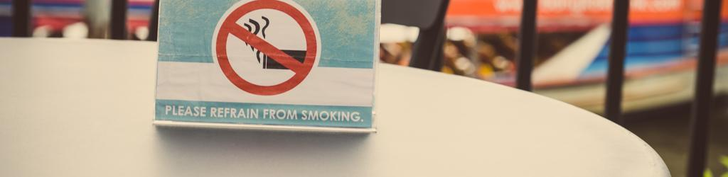 A no smoking sign sits on a table